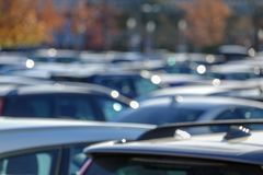 Cars in parking lot, out of focus royalty free stock images