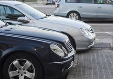 Cars in the parking lot in row royalty free stock photography