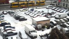 Cars in parking lot stuck under snow. During freezing winter stock video