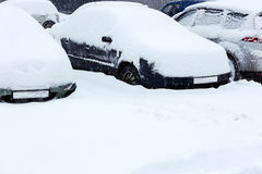 Cars on the parking lot under snow Royalty Free Stock Photography