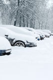 Cars on the parking lot under snow Royalty Free Stock Photo