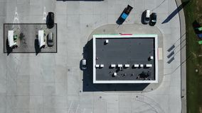Cars on the parking near the store at the petrol station. Aerial: Gas station. Cars on the parking near the store at the petrol station. 4K drone vertical shot stock video