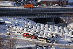 Cars on parking and street covered with big snow layer. View of winter and snowing on city street with snowflakes. In snowy season, motor vehicles with lot stock images
