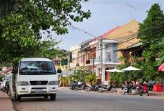 Cars parking on street in Kampot, Cambodia.  Royalty Free Stock Photos