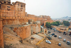 Cars parking under the Jaisalmer Fort, one of the largest fortifications in the world, India Royalty Free Stock Images