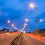 Cars pass on a city road at evening Royalty Free Stock Image