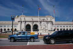 Cars pass in front of the Union train station in Washington DC, USA Royalty Free Stock Photo