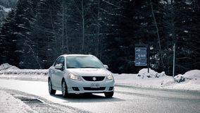 Cars Pass On Winter Highway In The Sun stock footage
