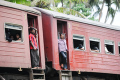 Cars of the passenger train with people. COLOMBO - OCTOBER 2013: cars of the passenger train with people Royalty Free Stock Photos