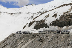 Cars with passengers stuck due to landslide. Leh India - July 7, 2015: Cars with passengers stuck at the pass on the way to Nubra valley in Leh, India due to Royalty Free Stock Photos