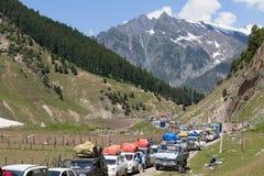 Cars with passengers stuck at the pass on the way Srinagar - Leh, Himalayas. India Royalty Free Stock Images