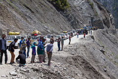 Cars with passengers stuck at the pass on the way Srinagar - Leh, Himalayas. India Stock Image