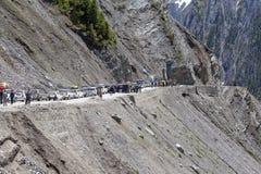 Cars with passengers stuck at the pass on the way Srinagar - Leh, Himalayas. India Royalty Free Stock Photography