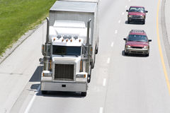 Cars Passing Big Truck On The Interstate Royalty Free Stock Images