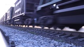 Cars passing freight train on rails stock video footage