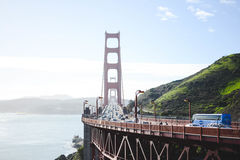 Cars Passing by Golden Gate Bridge during Daytime Stock Photography