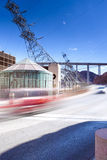 Cars Passing by over the Hoover Dam at Noon Stock Images