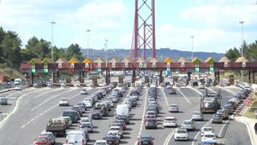 Cars passing through the point of toll highway, toll station near the bridge. Lisbon, portugal. Cars passing through the point of toll highway, toll station stock video footage