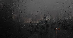 Cars passing by a rainy window at night 4k 24fps. Cars passing by a rainy window at night stock video footage