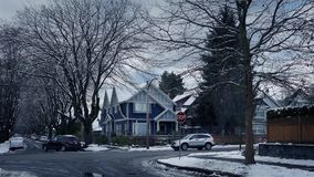 Cars Passing Through Suburbs In Winter stock video
