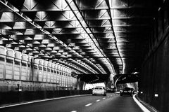 Cars passing a tunnel from Cinque Terre. Italy Royalty Free Stock Photo