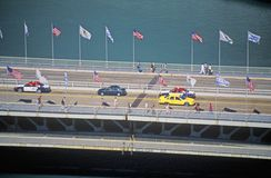 Cars and pedestrians cross over the Chicago River on Michigan Avenue in Chicago, Illinois Stock Photos