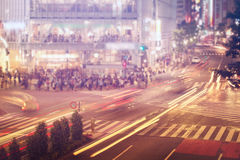 Cars and people crossing a busy Tokyo intersection. People and vehicles cross the  famously busy Shibuya intersection in Tokyo Stock Photography