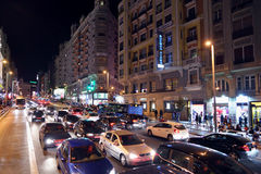 Cars and people at Gran Via street at night Stock Photos