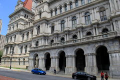 Cars and people outside stunning architecture of Albany's State Building, New York,2015 Royalty Free Stock Images