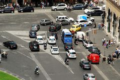 Cars and people in Rome city Royalty Free Stock Photography