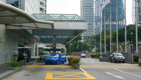 Cars and people on the street in Singapore Royalty Free Stock Photography