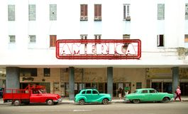 Cars and pick up park in front of a movie theater in Havana Cuba royalty free stock photos