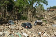 Cars in a pile of garbage at the site of the zoo Stock Photo