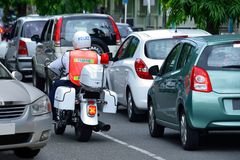 Cars & policeman in traffic jam Stock Images