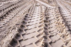 Cars protectors traces on the gravel Royalty Free Stock Image
