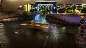Cars in queue at entrance in underground parking of hypermarket stock footage