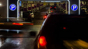 Cars in queue at entrance in underground parking of hypermarket. Time lapse stock video footage