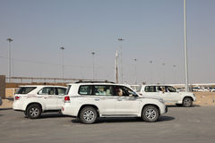 Cars of racing camels owners, Qatar Royalty Free Stock Images