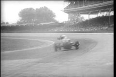 Cars racing at the Indy 500 stock video footage