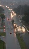 Cars in the rain royalty free stock photos