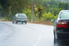 Cars in the rain. Driving in the rain with wet roads Stock Image