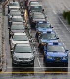 Cars in the rain. Bedok, Singapore - Oct 23,2010 : Singapore cars driving in rainy season on Bedok road Stock Photography