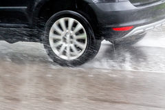 Cars in the rain. Car driving in the rain on a wet road. danger of aqua planning and accidents stock photos