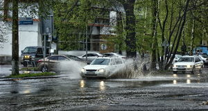 Cars and rain. Cars move through the streets of the city in time of rain royalty free stock photo