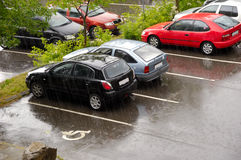 Cars on a rainy day. Parked cars. It is raining Royalty Free Stock Image