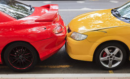 Cars Red Yellow touch close Stock Images