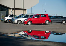 Cars reflected in carpark Stock Photos