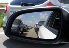 Cars reflections in side mirror of vehicle on the road Royalty Free Stock Photography