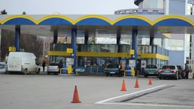 Cars Refuel In Gas Station. Cars at the filling station refuel with combustible. Suitable video for a wide range of subjects like global economy, petrol price stock footage