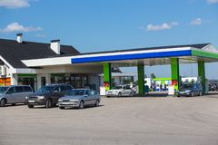 Cars are refueled by petrol. At the filling station royalty free stock image